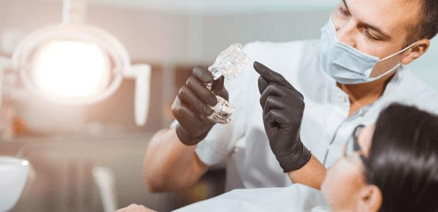 Dentist explaining a dental procedure to a patient