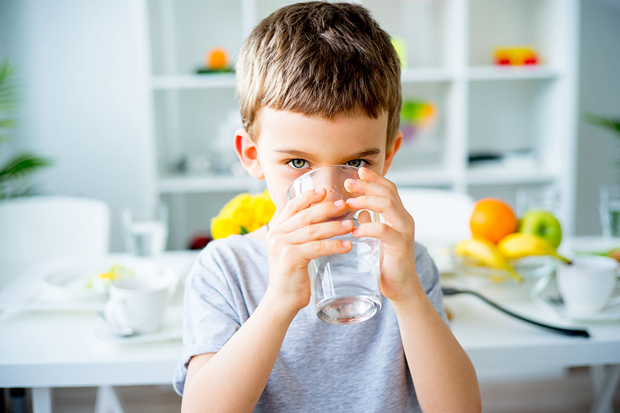Child drinks from a glass